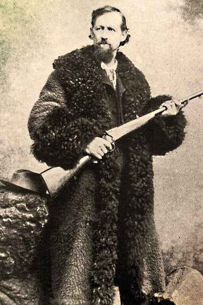 "A contributor to the slaughter, Charles ""Buffalo"" Jones wears a buffalo coat, a heavy and super warm overcoat mainly worn on the frontier by stagecoach drivers and other folks who had to sit in the cold for extended periods. – True West Archives –: http://www.truewestmagazine.com/the-buffalo-hunters-war/"