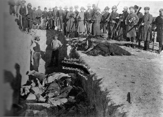 Burial Pit at Wounded Knee (https://en.wikipedia.org/wiki/Wounded_Knee_Massacre)